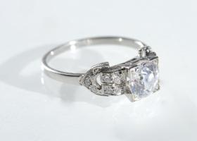 Art Deco diamond flanked solitaire engagement ring