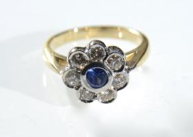 Vintage sapphire and diamond daisy cluster ring
