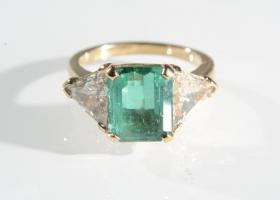 Three stone Colombian emerald and diamond ring