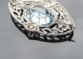 Aquamarine and diamond brooch.