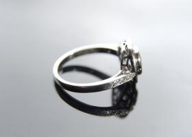 Diamond and sapphire target ring