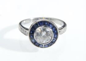 Art Deco style diamond and sapphire target ring in platinum