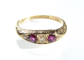 Antique engraved five stone diamond and ruby ring