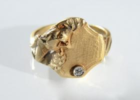 Art Nouveau tiger signet ring set with a diamond in 14kt yellow gold