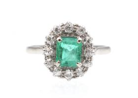 Vintage emerald and diamond oval cluster ring in platinum