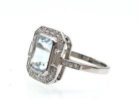 Art Deco style aquamarine and diamond cluster ring in platinum