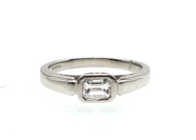 Art Deco emerald cut east to west diamond solitaire