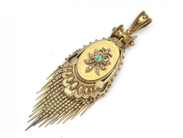 Antique emerald and seed pearl oval tassel locket in gold