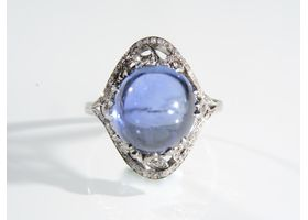 Antique Ceylon sapphire cabochon and diamond ring