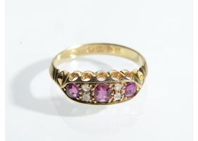 Edwardian ruby and diamond three stone band in gold