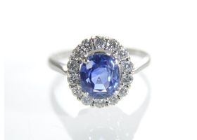 Vintage sapphire and diamond oval cluster ring in 18kt white gold
