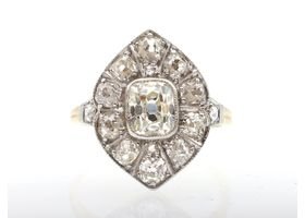 Antique curved navette diamond cluster ring in platinum and gold