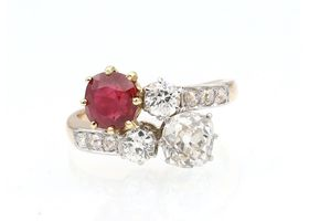 Pigeon blood Burmese ruby and diamond crossover ring in platinum and gold