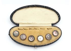 Antique mother of pearl silver and base metal buttons