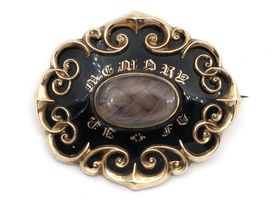 Antique memorial brooch with hair art and black enamel in yellow gold