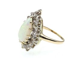 Vintage pear shape precious opal and diamond cluster ring in gold