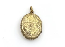 Antique Irish harp locket set with emeralds in yellow and green gold