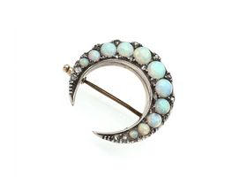 Victorian opal set crescent moon brooch in silver on gold