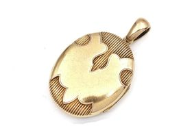 Victorian 15kt yellow gold oval locket with polished banner