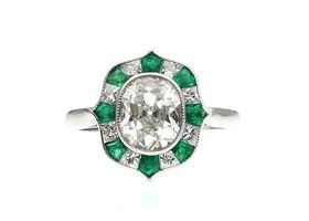 Art Deco style oval brilliant cut diamond and emerald target ring