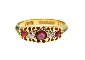 Antique five stone ruby and diamond ring in 18kt yellow gold
