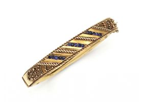 Vintage hollow 9kt yellow gold hinged bangle set with sapphires