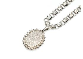 Antique sterling silver chain and large elaborate oval locket