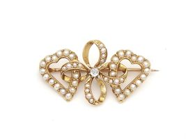 Victorian diamond and seed pearl lover's knot brooch
