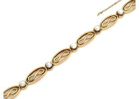 French 18kt yellow gold infinity bracelet set with pearls