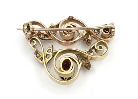 Garland style ruby and diamond brooch in yellow gold