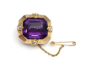 Amethyst and Old Mine cut diamond brooch in yellow gold