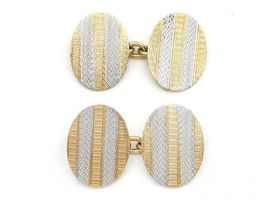 Antique oval engine turned platinum and yellow gold cufflinks