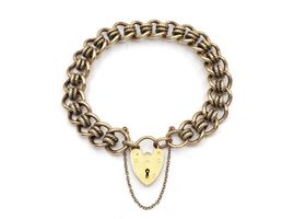 1987 solid yellow gold curb bracelet with heart lock