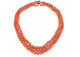 Antique beaded three strand coral necklace with silver clasp