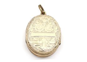 Antique 9kt yellow gold oval family locket