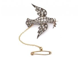 Victorian diamond and ruby dove and olive branch brooch