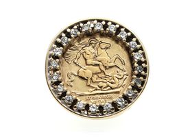 Vintage 9kt yellow gold coin ring with a border of cubic zirconias