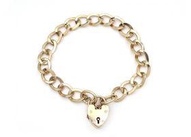 1967 oval curb link heart lock bracelet in yellow gold