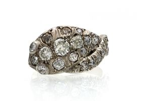 Vintage diamond set serpent ring in silver and rose gold