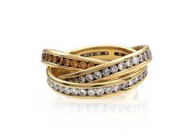 Three interlocking diamond and fancy cognac diamond eternity bands