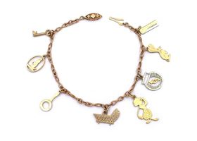 Vintage charm bracelet with eight charms in 9kt yellow gold