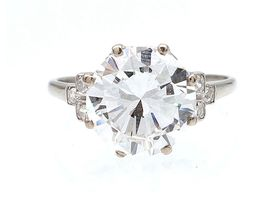 Edwardian 3.98ct diamond solitaire ring with diamond set shoulders