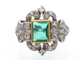 Art Deco emerald and diamond cluster ring in gold and platinum